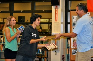 A student receives his certificate and the Complete Works of William Shakespeare